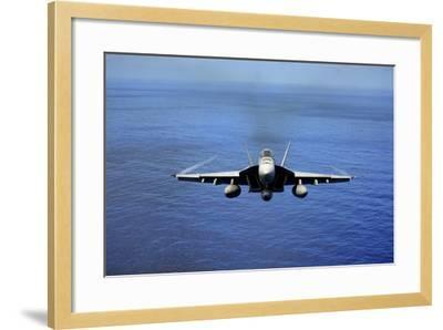 An F-A-18E Super Hornet over the Pacific Ocean--Framed Photographic Print