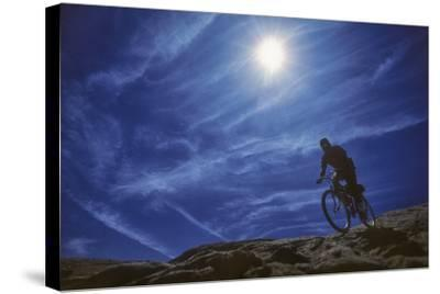A Mountain Biker on Slickrock Trail Near Moab, Utah-David Hiser-Stretched Canvas Print