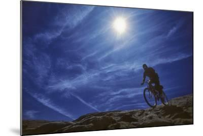 A Mountain Biker on Slickrock Trail Near Moab, Utah-David Hiser-Mounted Photographic Print