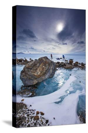 Expedition team members trek over blue glacial ice.-Cory Richards-Stretched Canvas Print