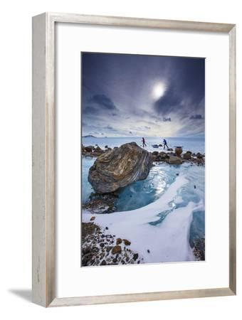Expedition team members trek over blue glacial ice.-Cory Richards-Framed Photographic Print