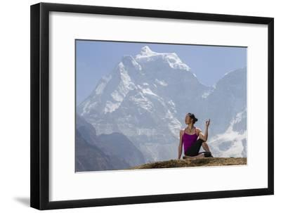 A Woman Practices a Half Spinal Twist Pose or Ardha Matsyendrasana-Cory Richards-Framed Photographic Print