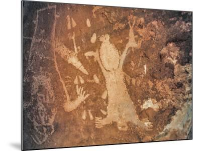 A Rare Anasazi Petroglyph on a Sandstone Boulder Thought to Depict Childbirth-David Hiser-Mounted Photographic Print