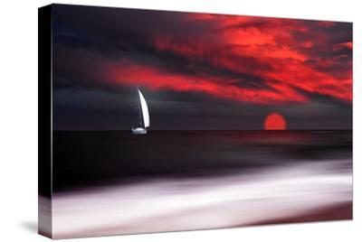 White sailboat and red sunset-Philippe Sainte-Laudy-Stretched Canvas Print