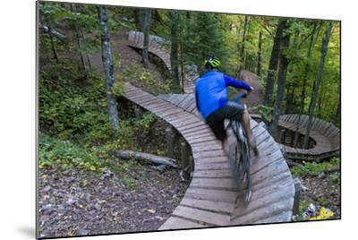 Mountain biking on the Over the Edge Trail, Copper Harbor, Michigan-Chuck Haney-Mounted Photographic Print