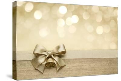 Golden Ribbon Bow with Bokeh, Christmas Decoration-Liang Zhang-Stretched Canvas Print