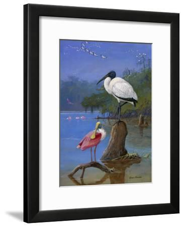 A Wood Ibis Perches with a Roseate Spoonbill on Dead Tree Limbs-Allan Brooks-Framed Giclee Print
