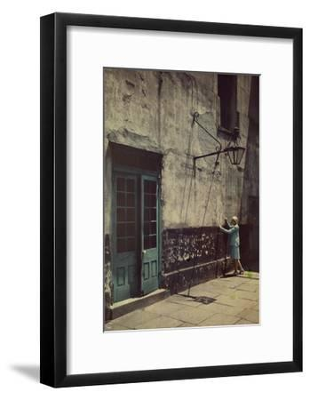 A Woman Touches the Wall of the Municipal Building for the Cabildo-Edwin L^ Wisherd-Framed Photographic Print