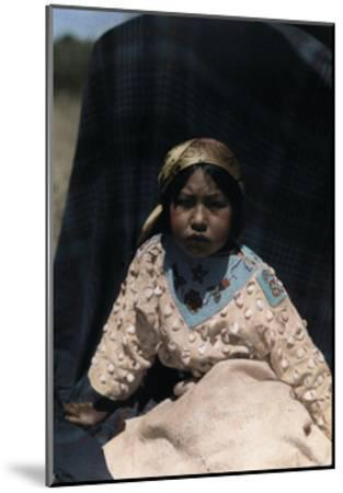 A Crow Indian Child Wears a Buckskin Dress of Beads and Teeth-Edwin L^ Wisherd-Mounted Photographic Print