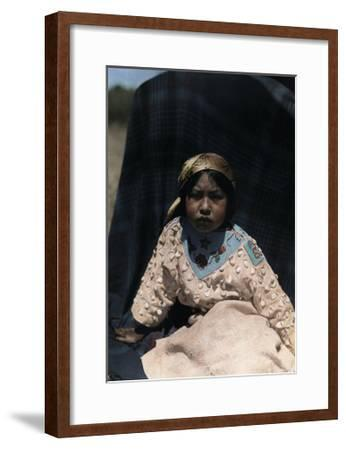 A Crow Indian Child Wears a Buckskin Dress of Beads and Teeth-Edwin L^ Wisherd-Framed Photographic Print