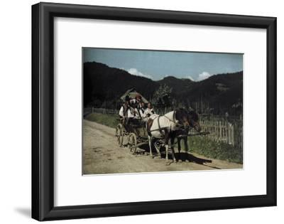 People Ride in a Cart Pulled by Two Horses-Hans Hildenbrand-Framed Photographic Print