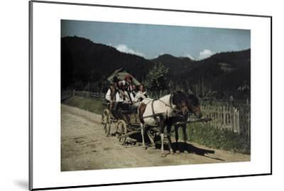 People Ride in a Cart Pulled by Two Horses-Hans Hildenbrand-Mounted Photographic Print