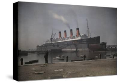 "A View of the Cunard S.S. ""Mauretania"" at Dock-Clifton R^ Adams-Stretched Canvas Print"