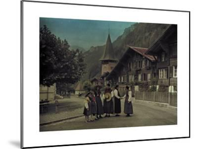 A Group of Mothers and Daughters Pose on a Village Street Corner-Hans Hildenbrand-Mounted Photographic Print
