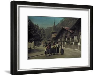 A Group of Mothers and Daughters Pose on a Village Street Corner-Hans Hildenbrand-Framed Photographic Print