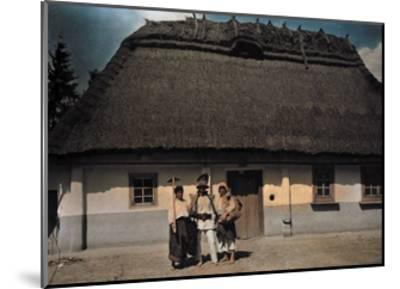 Three People Stand in Front of a House after Returning from Work-Hans Hildenbrand-Mounted Photographic Print