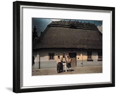 Three People Stand in Front of a House after Returning from Work-Hans Hildenbrand-Framed Photographic Print