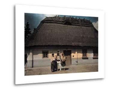 Three People Stand in Front of a House after Returning from Work-Hans Hildenbrand-Metal Print