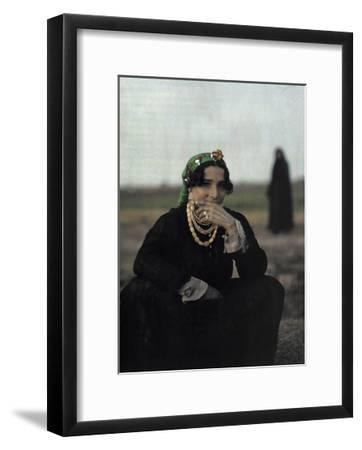 A Peasant Singer Poses in a Seated Position-Gervais Courtellemont-Framed Photographic Print
