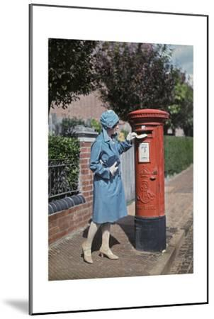 A Young Woman Mails a Letter at the Pillar Box-Clifton R^ Adams-Mounted Photographic Print