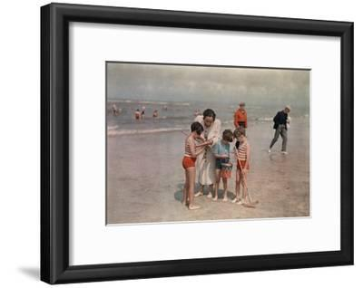 A Lady Examines a Girl's Net While the Other Kids Look at their Own-W^ Robert Moore-Framed Photographic Print