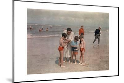 A Lady Examines a Girl's Net While the Other Kids Look at their Own-W^ Robert Moore-Mounted Photographic Print