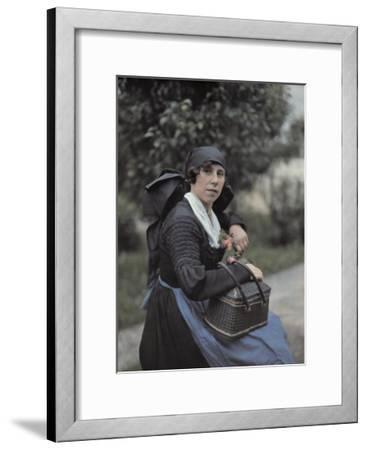 A Woman Sits on a Garden Ledge with Flowers and Her Straw Basket-Hans Hildenbrand-Framed Photographic Print