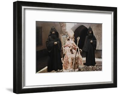 A Reverend Is Seated Between Two Assistants-Maynard Owen Williams-Framed Photographic Print