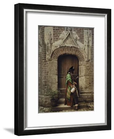 A Woman and Child Use the Yard Door to Exit the Castle-Gervais Courtellemont-Framed Photographic Print