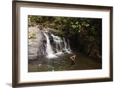 A Woman Standing in a Pool at the Base of a Small Waterfall-Sergio Pitamitz-Framed Photographic Print