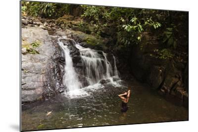 A Woman Standing in a Pool at the Base of a Small Waterfall-Sergio Pitamitz-Mounted Photographic Print