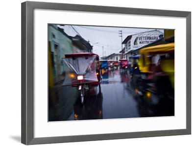 Traffic Headlights Swirl Past an Auto Rickshaw on a Rainy Night in an Amazon River Town-Jason Edwards-Framed Photographic Print