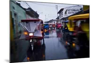 Traffic Headlights Swirl Past an Auto Rickshaw on a Rainy Night in an Amazon River Town-Jason Edwards-Mounted Photographic Print