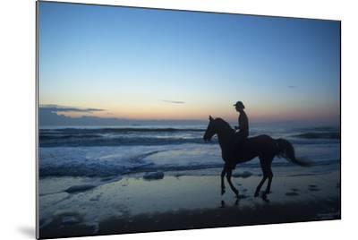 A Cowboy on Virginia Beach, Virginia-Joel Sartore-Mounted Photographic Print
