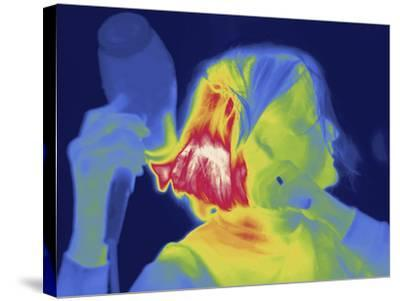 Thermal Image of a Woman Blow Drying Her Hair-Tyrone Turner-Stretched Canvas Print