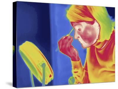 Thermal Image of a Woman Applying Makeup-Tyrone Turner-Stretched Canvas Print