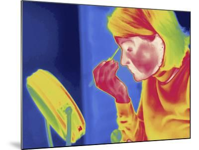 Thermal Image of a Woman Applying Makeup-Tyrone Turner-Mounted Photographic Print