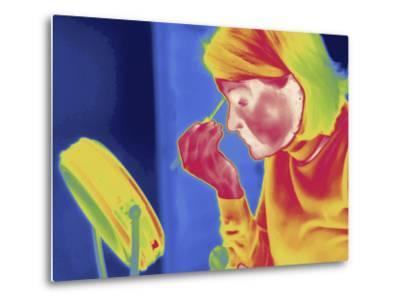 Thermal Image of a Woman Applying Makeup-Tyrone Turner-Metal Print