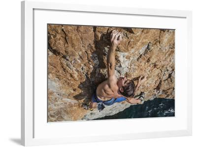 A Climber, Without Ropes, Scales a Cliff Rising from the Gulf of Oman-Jimmy Chin-Framed Photographic Print