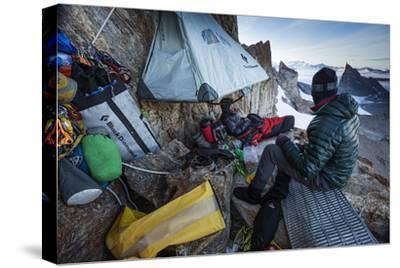 Expedition Team Members Try to Stay Warm on a Ledge of Bertha's Tower,1,200 Feet Above the Ground-Cory Richards-Stretched Canvas Print