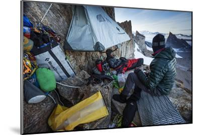 Expedition Team Members Try to Stay Warm on a Ledge of Bertha's Tower,1,200 Feet Above the Ground-Cory Richards-Mounted Photographic Print