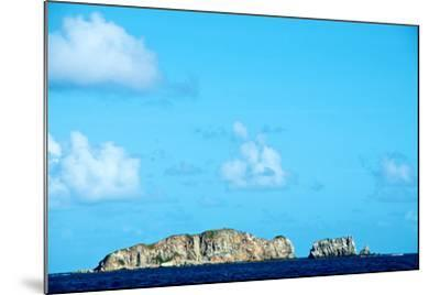 Blue Sky with Puffy Clouds over Rock Formations Off the Coast of the British Virgin Islands-Heather Perry-Mounted Photographic Print