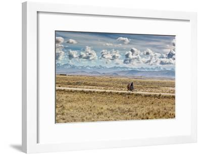 A Man Cycles with a Family Member on the Back of His Bicycle Between La Paz and Tiwanaku-Alex Saberi-Framed Photographic Print