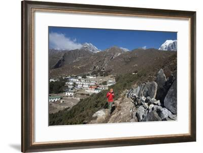 A Hiker Walks Past a Wall of Mani Stones Inscribed with an Ancient Tibetan Mantra-Alex Treadway-Framed Photographic Print