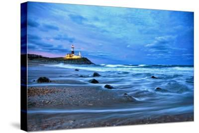 The Montauk Point Lighthouse Shining at Dusk-Robbie George-Stretched Canvas Print