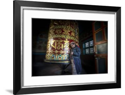 An Old Tibetan Woman Spins a Prayer Wheel While Counting Through a String of Rosary Beads-Alex Treadway-Framed Photographic Print