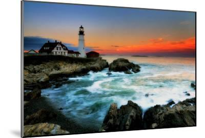 The Sun Setting Behind the Portland Head Light as Waves Surge onto the Rocky Shore-Robbie George-Mounted Photographic Print