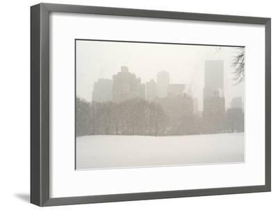 Manhattan Buildings and Trees in Central Park During a Blizzard-Kike Calvo-Framed Photographic Print