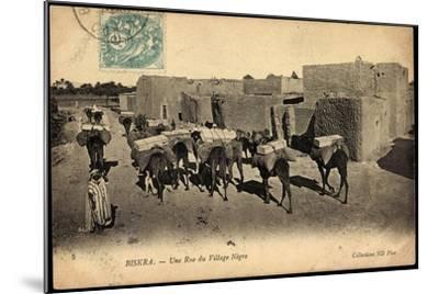 Biskra Algerien, Une Rue Du Village Nègre, Bepackte Kamele--Mounted Giclee Print