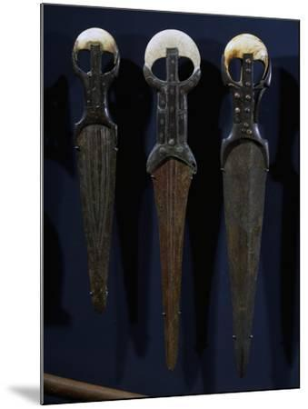 Bronze Swords and Daggers, with Electron Blades, Ivory Handles and Copper Nails--Mounted Giclee Print